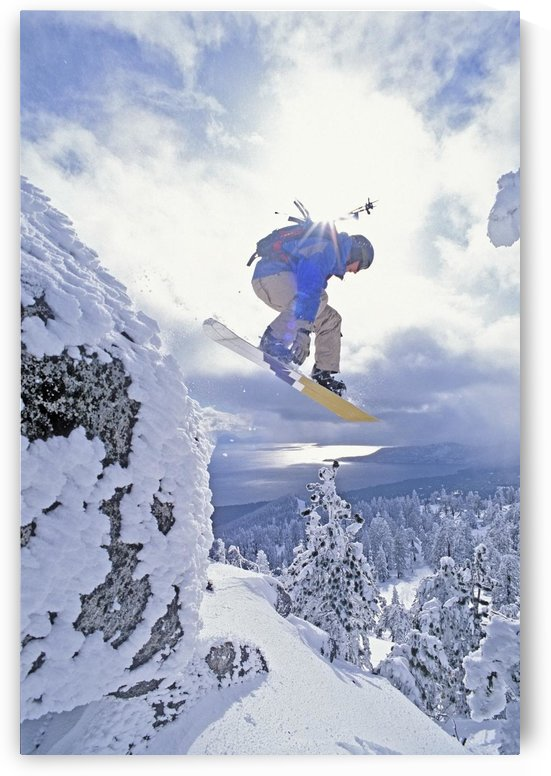 Diamond Peak, Lake Tahoe, Nevada, Usa; Man Snowboarding In Mid-Air by PacificStock