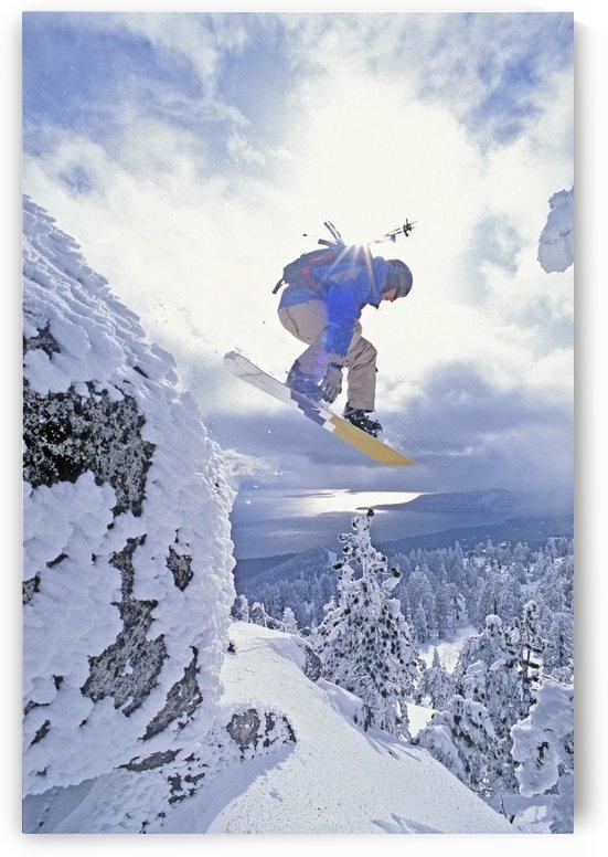 Diamond Peak, Lake Tahoe, Nevada, Usa; Man Snowboarding In Mid-Air by PacificStock