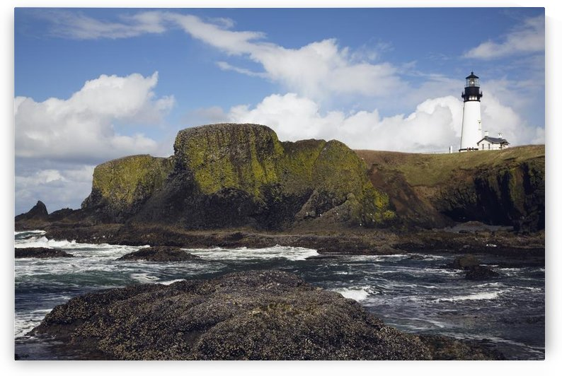 Lighthouse On Coastal Cliff by PacificStock