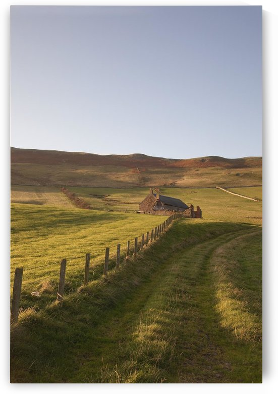 Northumberland, England; A Farm Structure And A Fence Around A Field by PacificStock