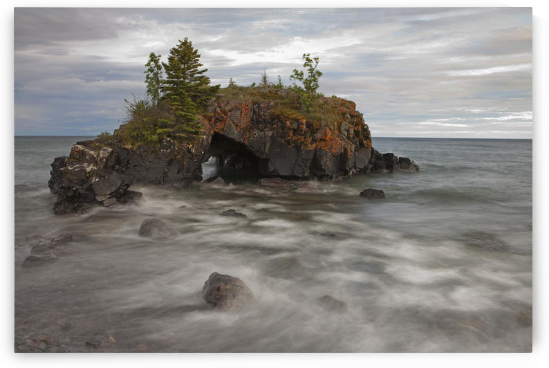 Water Coming Into Shore Around A Rock Formation On Lake Superior; Grand Portage, Minnesota, United States Of America by PacificStock