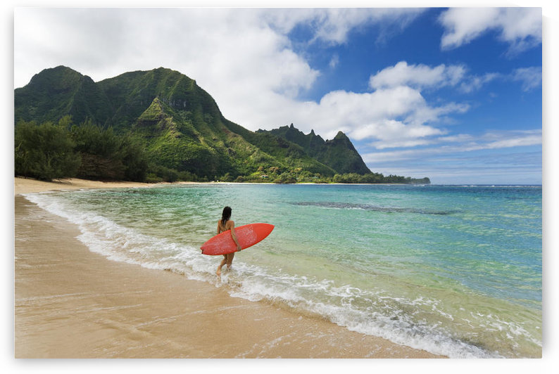 Hawaii, Kauai, Haena Beach Tunnels Beach, Woman Entering Ocean With Surfboard. by PacificStock