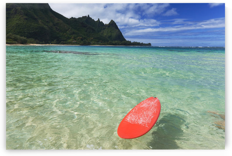 Hawaii, Kauai, Haena Beach Tunnels Beach, Red Surfboard Floating In Shallow Ocean. by PacificStock