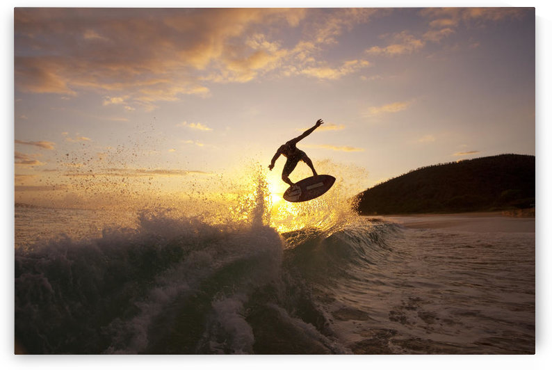 Hawaii, Maui, Makena, Skimboarder Gets Big Air Off A Wave At Sunset by PacificStock