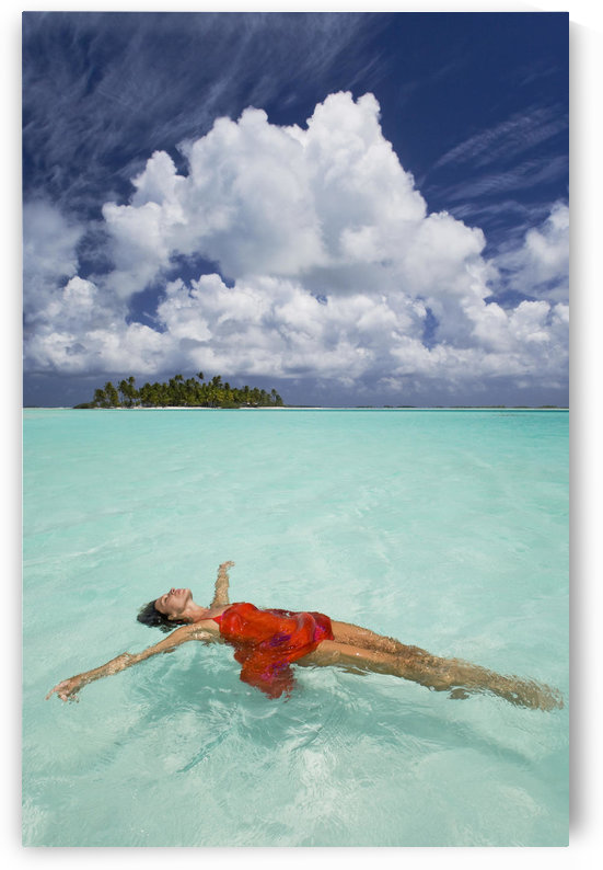 French Polynesia, Woman Floating In Ocean Water. by PacificStock