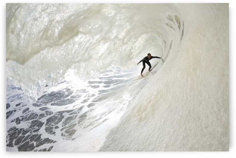 California, Ventura, Surfer In The Barrel On Foamy Ocean Wave. For Editorial Use Only. by PacificStock