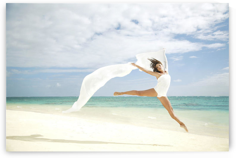Hawaii, Oahu, Lanikai Beach, Beautiful Female Ballet Dancer Leaping Into Air On Beach With White Flowing Fabric. by PacificStock