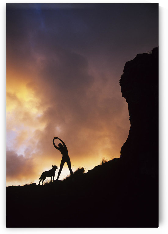 Hawaii, Silhouette Of A Woman Stretching On A Mountain Top At Sunset. by PacificStock