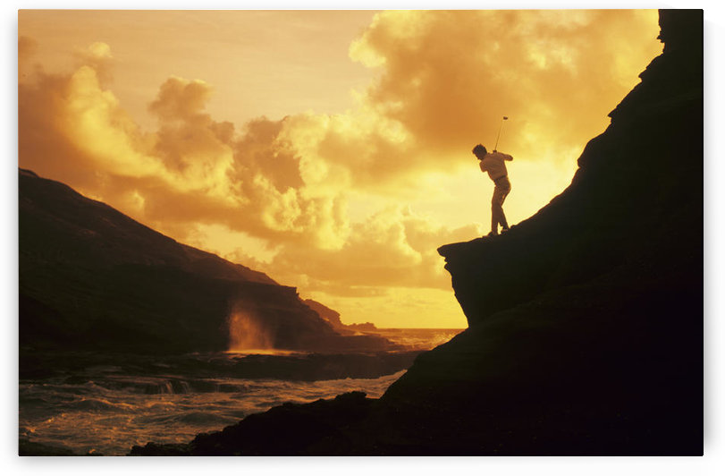 Hawaii, Golfer Standing On A Cliff And Swinging A Golf Club. by PacificStock