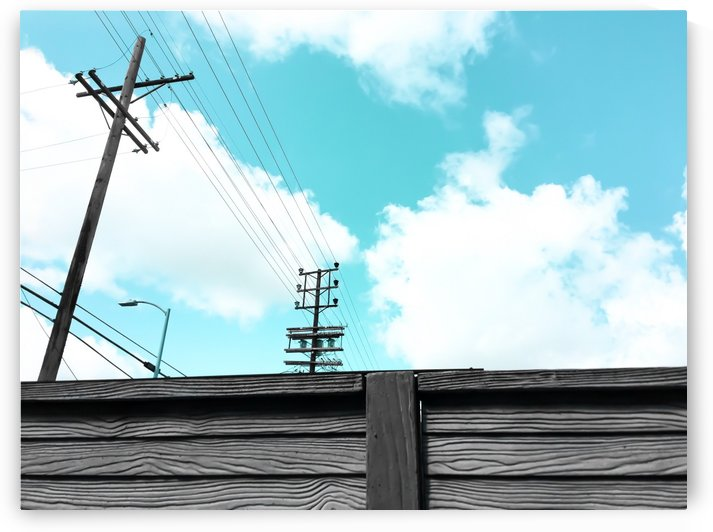 electric pole with wooden wall and blue cloudy sky in the city by TimmyLA