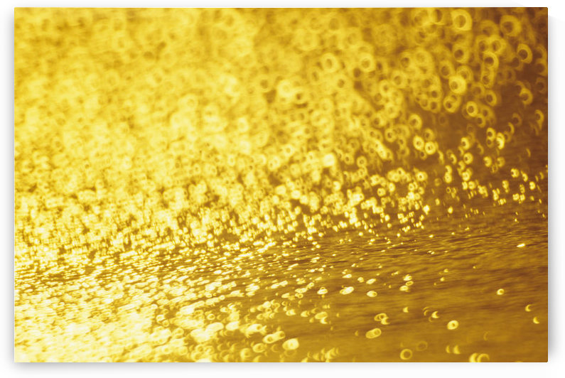 Closeup Of Golden Shimmering Reflections Off Water. by PacificStock
