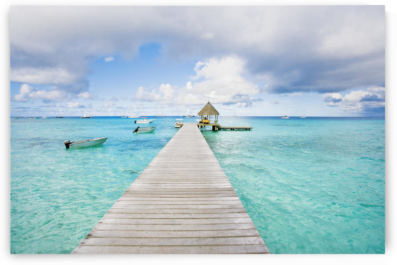 French Polynesia, Tuamotu Isalnds, Rangiroa Atoll, Pier On The Ocean. by PacificStock