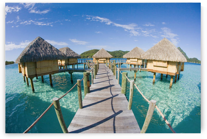 French Polynesia, Pearl Resort, Bungalows Over Beautiful Turquoise Ocean. by PacificStock