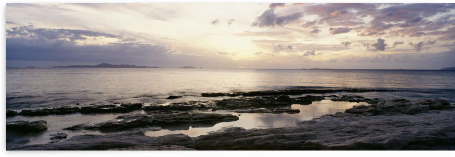 Sunrise Over Ocean And Rocky Coastline; Fiji by PacificStock