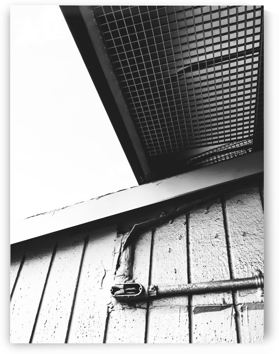 wood building in the city in black and white by TimmyLA