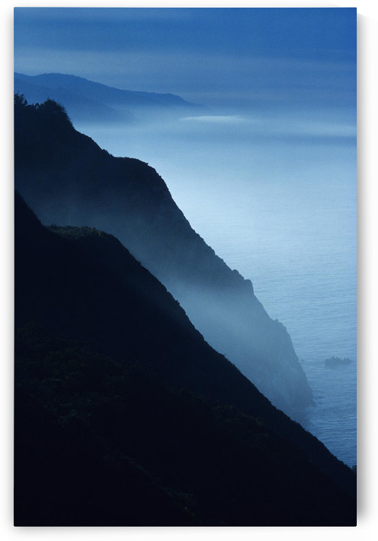 California, Big Sur Coast, Silhouetted Cliffs Along Foggy Ocean Shoreline. by PacificStock