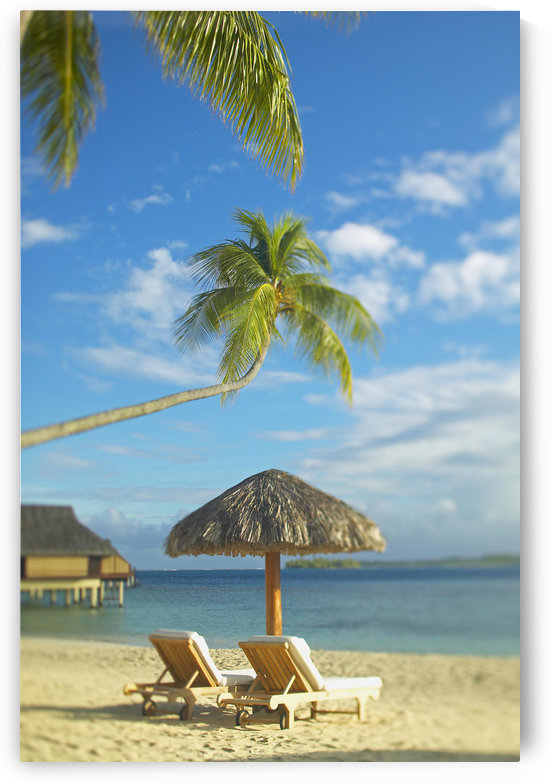 French Polynesia, Tahiti, Bora Bora, Lounge Chairs And Thatch Umbrella On Beach With Tranquil Ocean And Bungalows by PacificStock