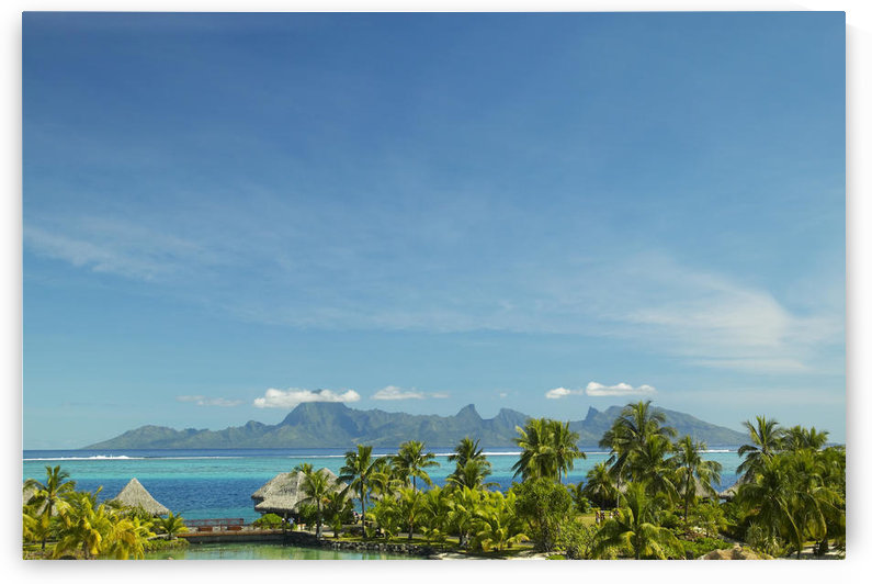 French Polynesia, Tahiti, View Of Moorea Across Turquoise Ocean, Palm Trees And Grass Huts In Foreground by PacificStock