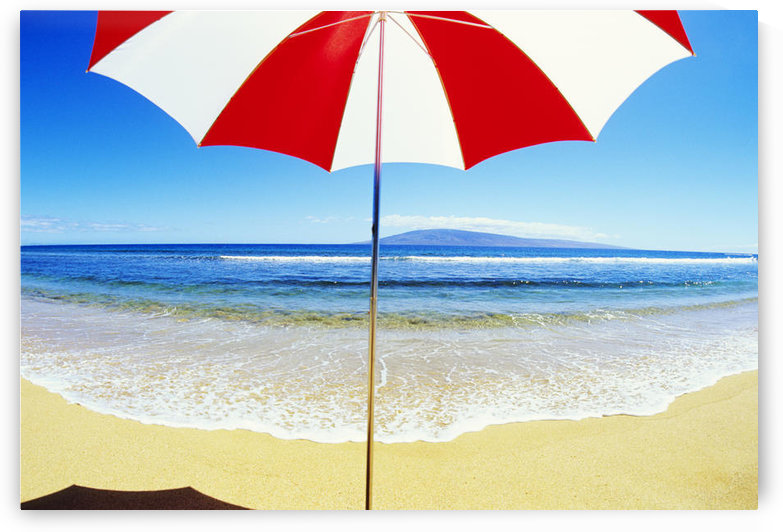 Red And White Umbrella On The Beach, Blue Sky And Ocean by PacificStock