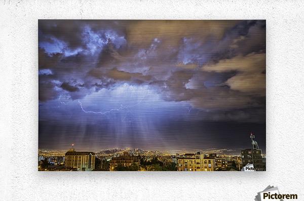 Lightning lights up the night skies above the city of Cochabamba; Cochabamba, Bolivia  Metal print