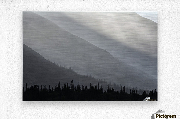 Light shines through the rain as it falls on the mountains along the Wind River in the Peel Watershed; Yukon, Canada  Metal print