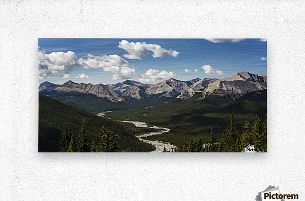 Panorama of river valley and mountain range with blue sky and clouds; Bragg Creek, Alberta, Canada  Metal print
