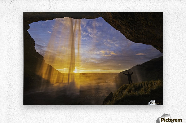 Man standing behind the waterfall known as Seljandafoss along the southern coast of Iceland; Iceland  Metal print