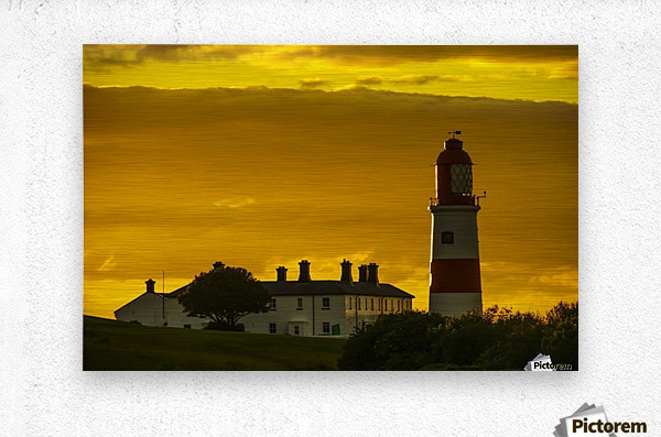 Souter Lighthouse under a glowing golden sky at sunset; South Shields, Tyne and Wear, England  Metal print