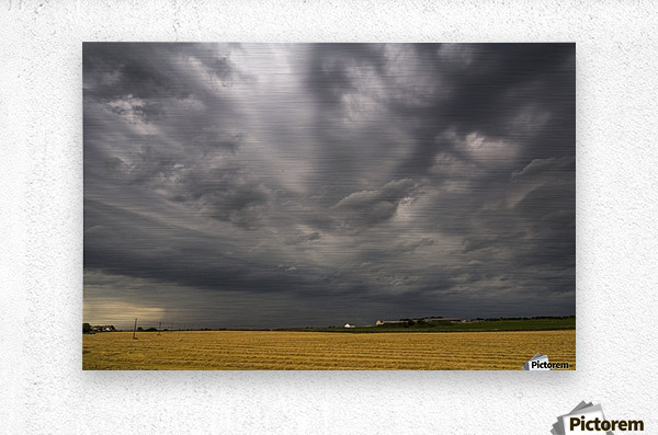Dark storm clouds over a farm field; Whitburn, Tyne and Wear, England  Metal print