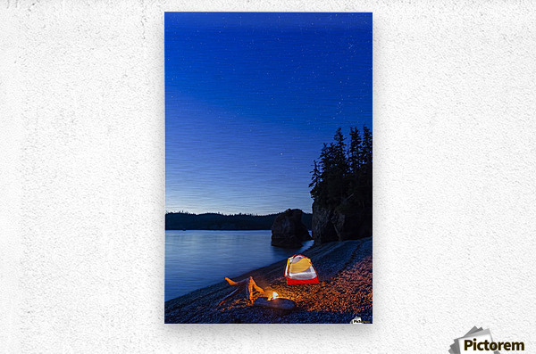 A campfire built on a beach at dusk next to a glowing tent, tranquil ocean water reflecting the warm light, Hesketh Island; Homer, Alaska, United States of America   Metal print