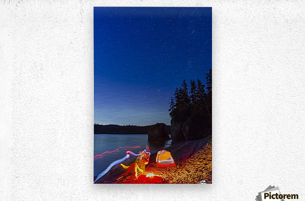 A campfire built on a beach at dusk next to a glowing tent and headlamp light trails, tranquil ocean water reflecting the warm light, Hesketh Island; Homer, Alaska, United States of America   Metal print