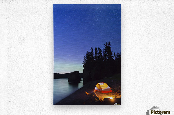 A glowing tent on a beach overlooks green Aurora Borealis reflected in the tranquil ocean water, Hesketh Island; Homer, Alaska, United States of America   Metal print