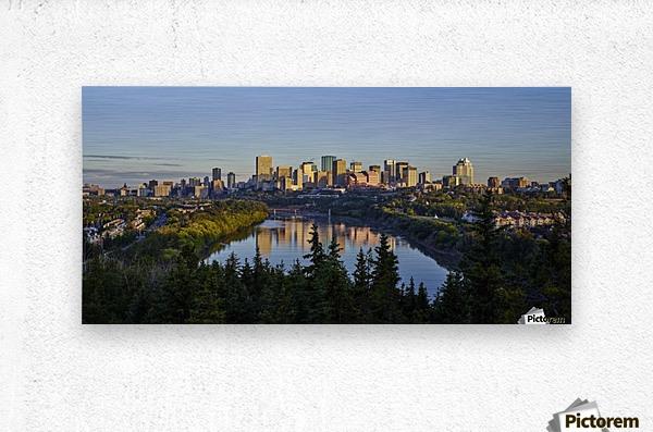 Skyline of downtown Edmonton reflected in the North Saskatchewan River under a blue sky; Edmonton, Alberta, Canada  Metal print