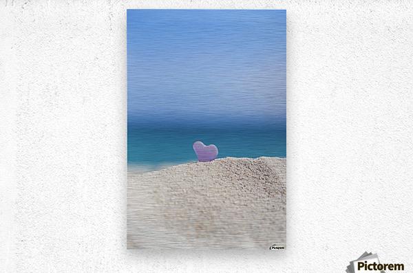 A lavender heart shaped sea glass in the sand at the beach; Honolulu, Oahu, Hawaii, United States of America  Metal print