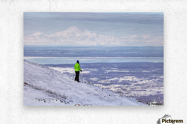 Woman snowshoer taking in the view of Mt. McKinley (Denali) from Blueberry Hill at the Glen Alps area of Chugach State Park, Anchorage, Southcentral Alaska, Winter, HDR  Metal print