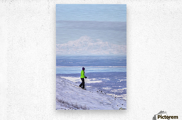 Woman snowshoeing on Blueberry Hill at the Glen Alps area of Chugach State Park with Mt. McKinley (Denali) in the background, Anchorage, Southcentral Alaska, Winter, HDR  Metal print