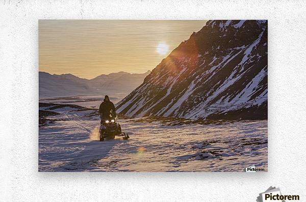 Man riding a snowmachine up the Anaktuvuk River Valley at sunset, Gates of the Arctic National Park, Brooks Range, Arctic Alaska  Metal print