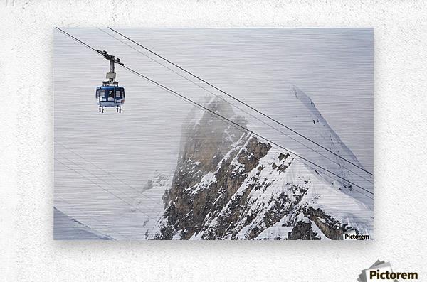 Scenic view of the Titlis Rotair revolving circular tram at Engelberg Resort in Switzerland  Metal print