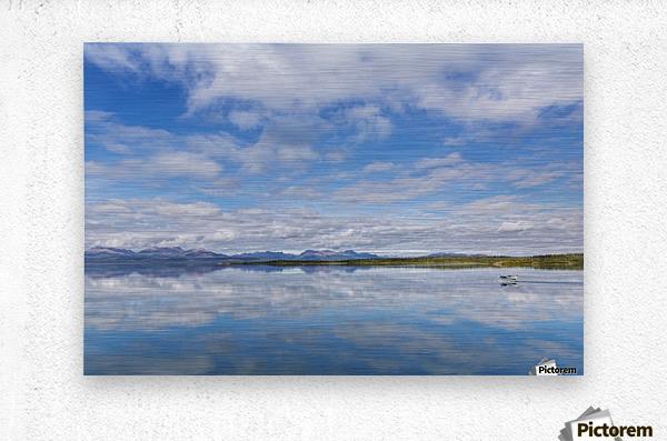 Light clouds reflect on the calm water of Tikchik Lake at the Tikchik Narrows Lodge, Wood Tikchik State Park, Southwestern Alaska; Alaska, United States of America  Metal print