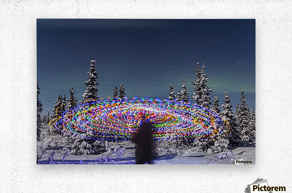 The Aurora Borealis dances over the top of a vibrant spiral light painting, the blurry figure of a man in the middle of the light painting, moonlight casting shadows on snow covered spruce trees on a clear winter night, interior Alaska; Gakona, Alaska, Un  Metal print