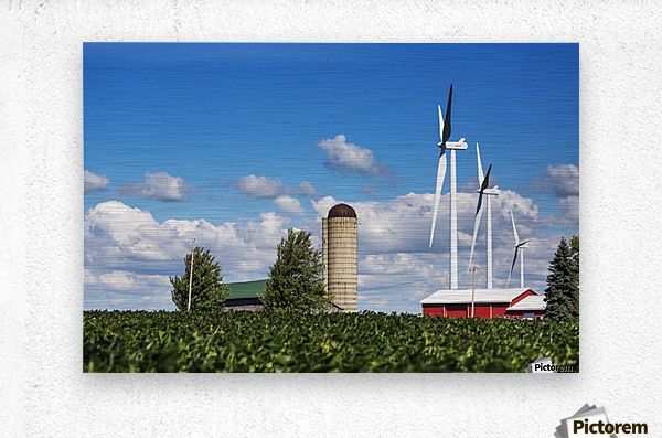 Large metal windmills in a farm yard with red barn and silo, soy bean field in the foreground and blue sky and clouds in the background; Ontario, Canada  Metal print