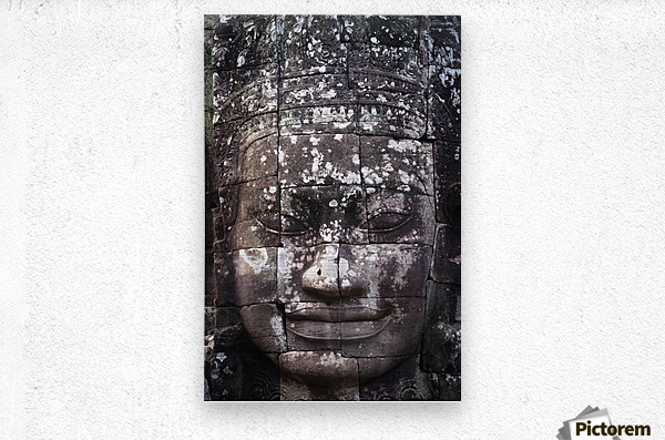 A face sculpture on a stone wall at angkor wat;Cambodia  Metal print