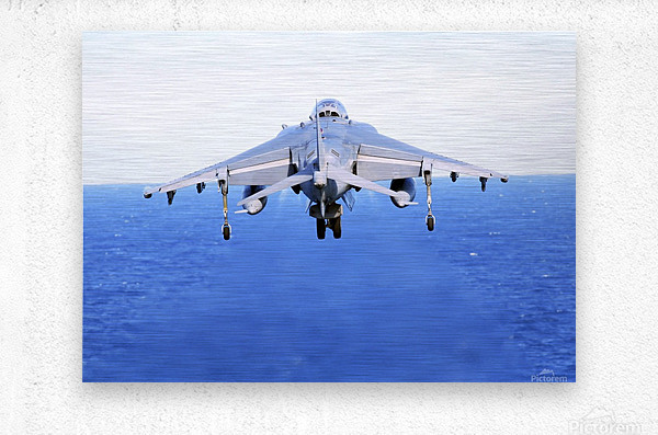 An AV-8B Harrier jet launches off the flight deck of USS Peleliu.  Metal print