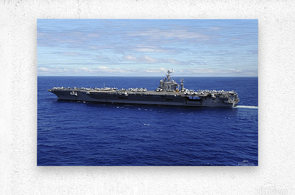 The aircraft carrier USS Abraham Lincoln transits across the Pacific Ocean.  Metal print