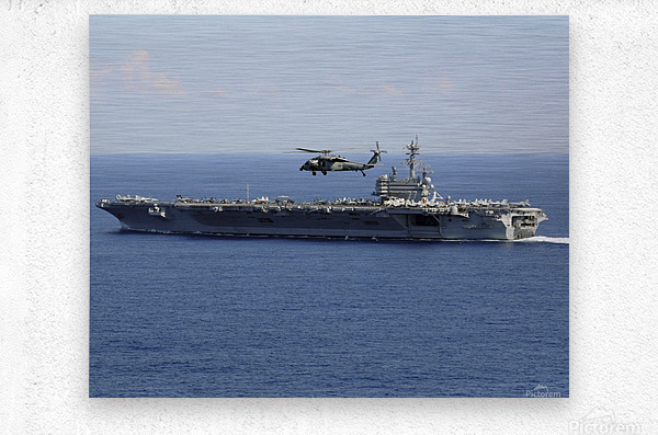 An MH-60S Seahawk helicopter flies over USS George H.W. Bush.  Metal print