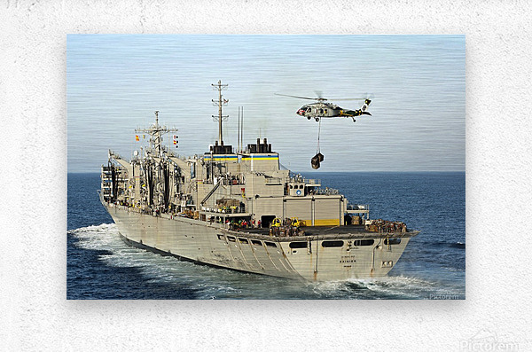 An MH-60S Knighthawk lifts cargo from the fast combat support ship USNS Rainier.  Metal print