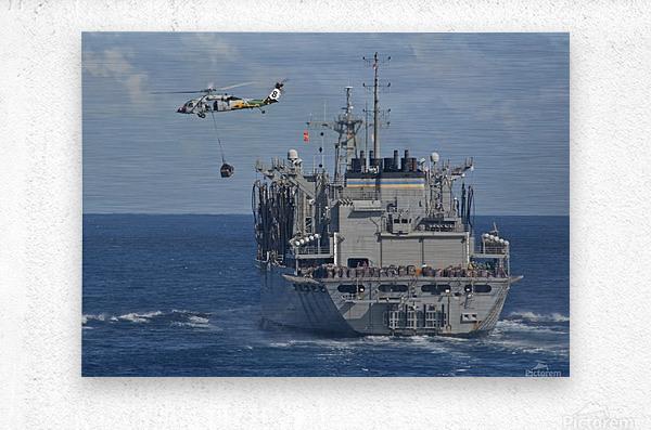 An MH-60S Sea Hawk conducts a vertical replenishment with USNS Bridge.  Metal print