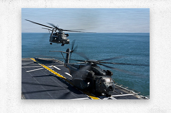 MH-53E Sea Dragon helicopters take off from the flight deck of USS Wasp.  Metal print