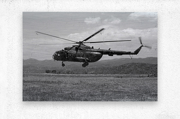 A Macedonian MI-17 helicopter landing as part of a medical transport flight.  Metal print