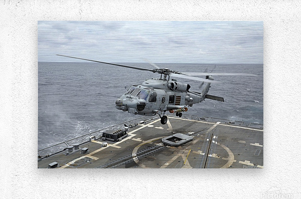 An MH-60R Sea Hawk helicopter lifts off from USS Wayne E. Meyer.  Metal print